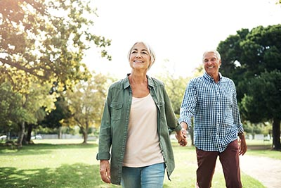 Older couple walking in a park