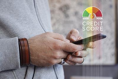 Man checking credit score on smart phone